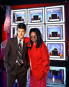 Tom Bergeron and Whoopi Goldberg on the set of HOLLYWOOD SQUARES, 1998